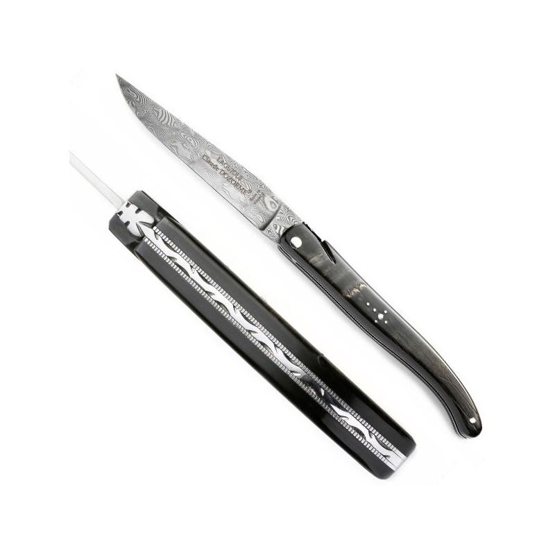 Sammlermesser mit Griff aus natürlichem Büffelhorn, Gezackte Struktur, gemeißelt.